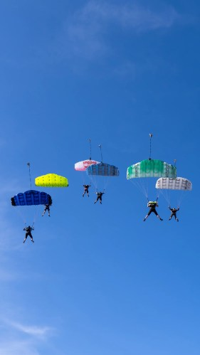 Skydivers flying their wings during a canopy skill camp