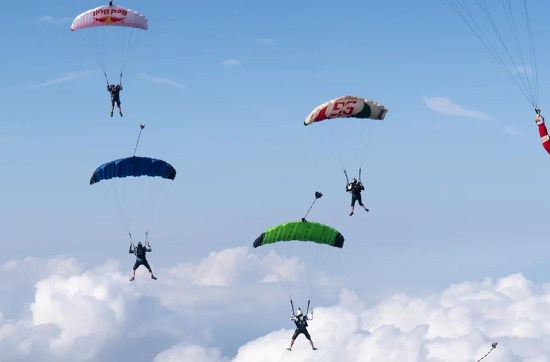 Skydivers flying their canopies during Flock Yeah event at skydive Empuriabrava