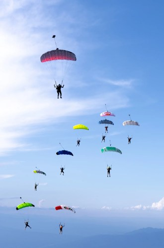 Skydivers flocking with canopies in Empuriabrava. Event by NZ Aerosports.