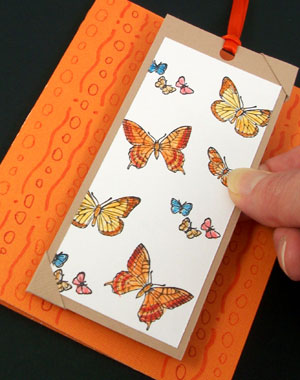 Put photocorners on opposite corners of bookmark and attach to card