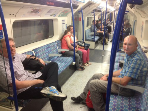 Weary travellers on the tube