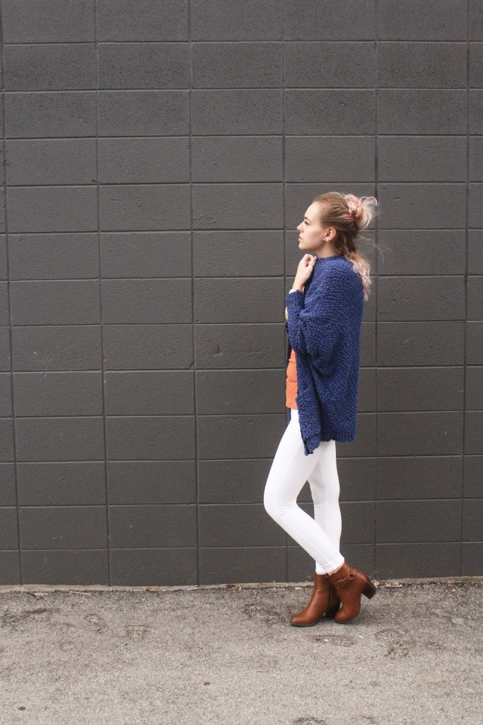 Wearing white pants and a cardigan