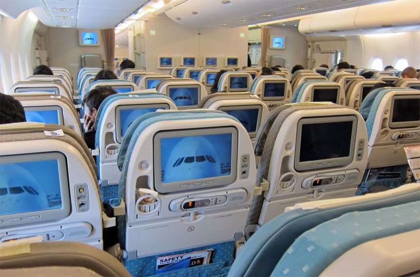 Try heading to the very back of the plane, which is less popular among most passengers, to find spare seats and fewer fellow travellers.