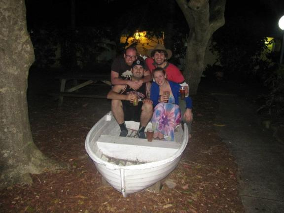 Magro, Dave, Steph, and I pose in a boat behind the Tea Gardens Pub
