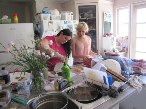 My sister and my brother's partner preparing Christmas lunch