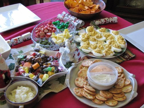Deviled eggs, cheese and crackers, and candy adorn the table