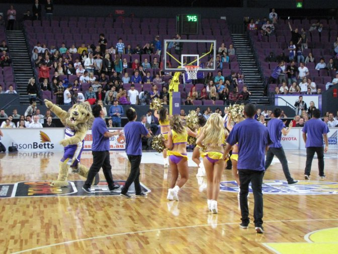 The mascot, cheerleaders, and dancers all celebrate the win