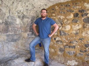 manly man in a cave