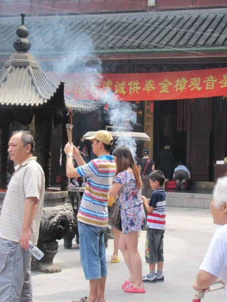Chinese people burn incense