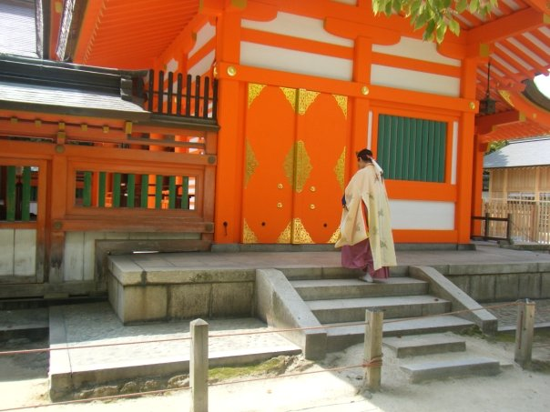 A monk enters a garishly coloured shrine
