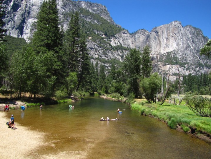 People play in a lazy Yosemite river