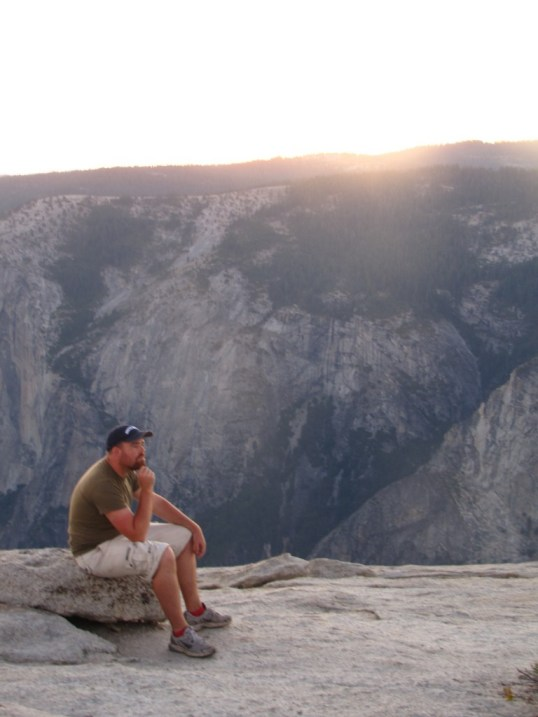 Pondering the beauty of Yosemite atop Sentinel Dome