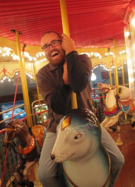 Deliriously happy on the San Francisco Carousel. Or am I happy about being warm?