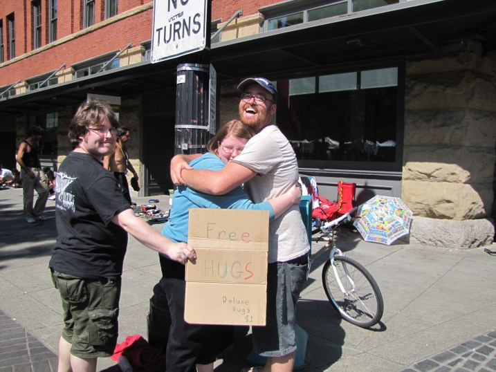 Getting some free hugs at the Portland Saturday Market.