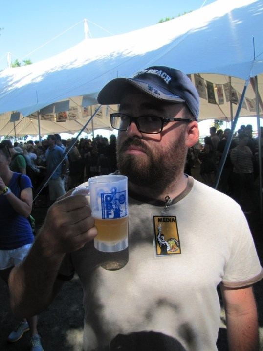 Enjoying a (free) beer at the Oregon Brewers Festival with my shiny media pass
