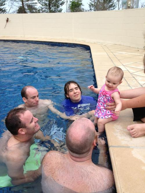 My brothers and I surround my adorable niece, Alchemy, while we're on holiday in QLD.