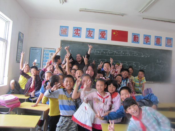 Celebrating a lesson's completion with the kids in Shuanggou, Jiangsu, China.