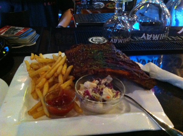 A sizable serving of ribs and fries at Jimmy's. Perfect with a cider.