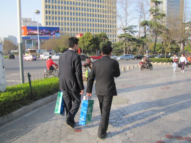 Two Chinese businessmen out for a Sunday stroll.