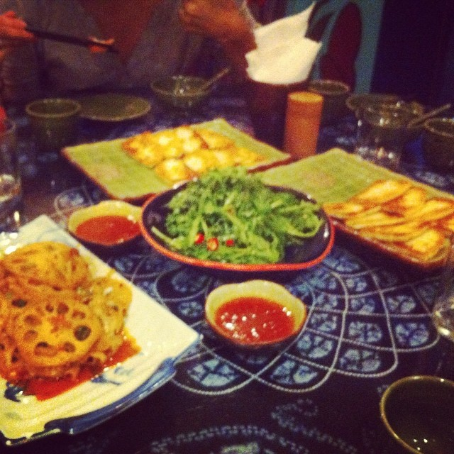 A feast of Yunnan dishes including lotus roots, fried goat cheese, buckwheat pancakes, and spicy cauliflower.