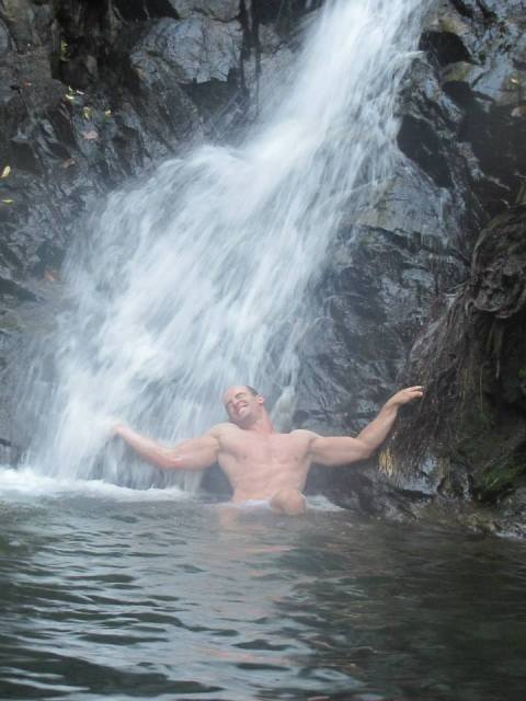 My ridiculously good looking brother showing off under the waterfall.