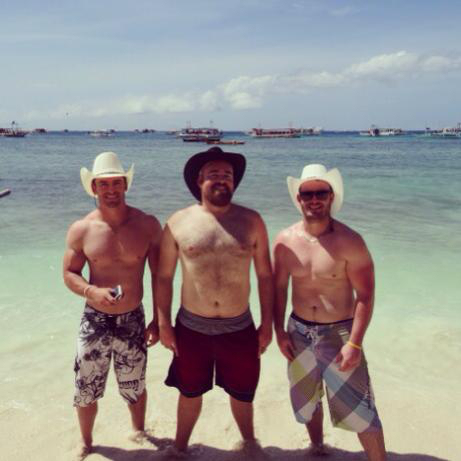 men in cowboy hats on the beach