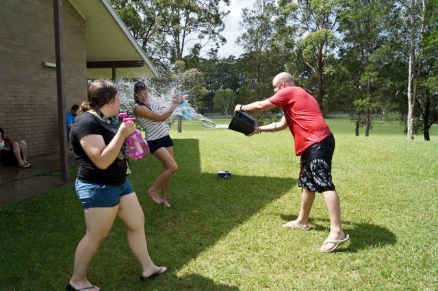 An impromptu water fight breaks out after water balloon volleyball.