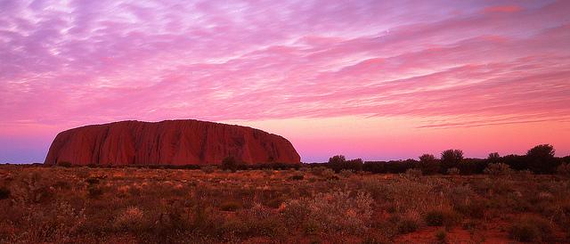 A stunning pink sunset over Uluru. Photo by Mark Wassell.