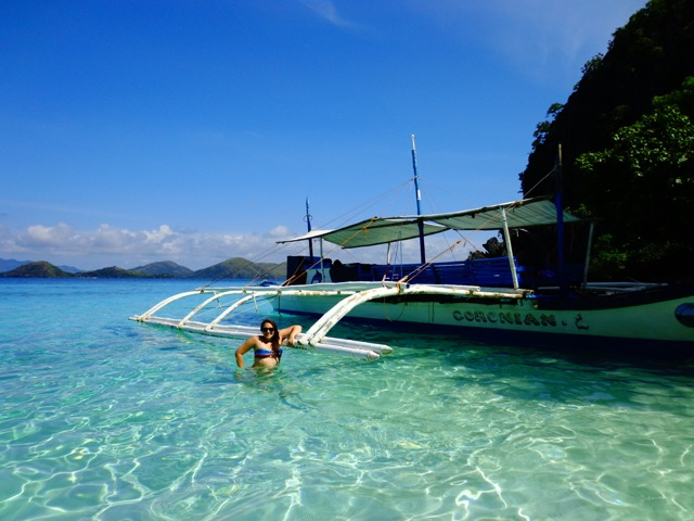longtail boat coron philippines beach girl