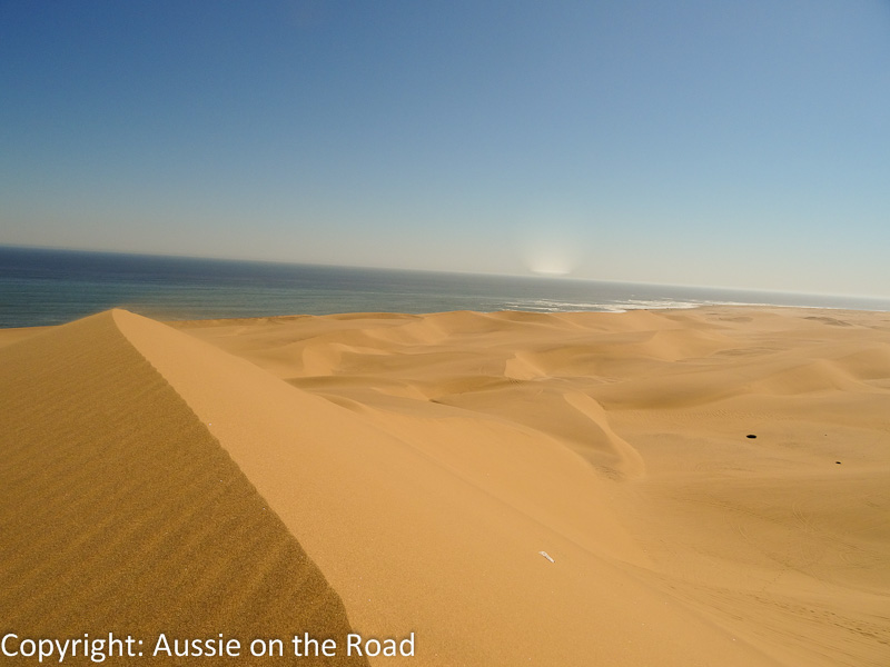 The towering dunes and parched desert give way to the churning Atlantic so suddenly that it seems implausible.