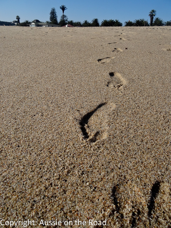 My foot steps in the sand along the beach in Swakopmund.