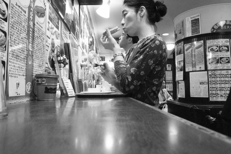lady eating in tokyo restaurant