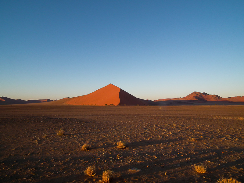 The first light of day paints the dunes of Sossusvlei in new colour.