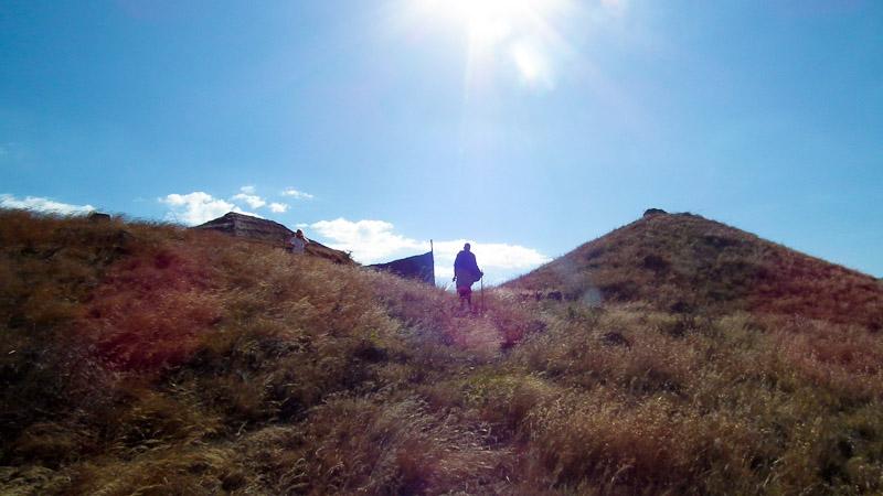 masai man walking sun