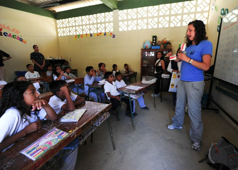teacher in a classroom teach english
