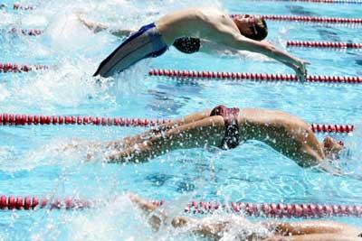 Backstroke swimmer in his speedos.