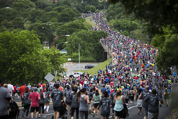 Thousands of runners overtake the street during the 2019 Statesman Capitol 10K run