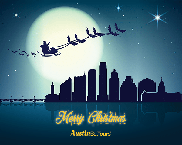 Santa's sleigh is pulled by a colony of bats over the Austin Skyline