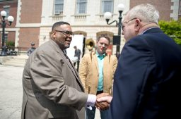 Alderman Chris Taliaferro, left, shakes hands with Tom Owens last Thursday, during a special kick-off event for Cleanslate at Austin Town Hall Park in Austin. Brady Gott looks on. | ALEXA ROGALS/Staff Photographer