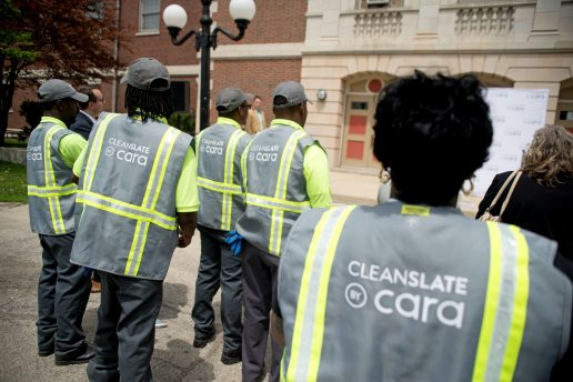 Cara Cleanslate workers wear their uniforms and listen to live music from Low Down Brass Band last Thursday, during a special kick-off event for Cara at the Austin Town Hall Park in Chicago's Austin neighborhood. | ALEXA ROGALS/Staff Photographer