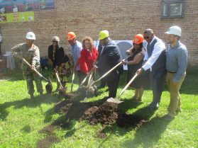 BREAKING GROUND: Elected officials, including West Side Ald. Chris Taliaferro (29th), fourth from left, and Cook County Commissioner Richard Boykin (1st), break ground on Austin Veterans Peace Garden on May 24. | IGOR STUDENKOV/Contributor
