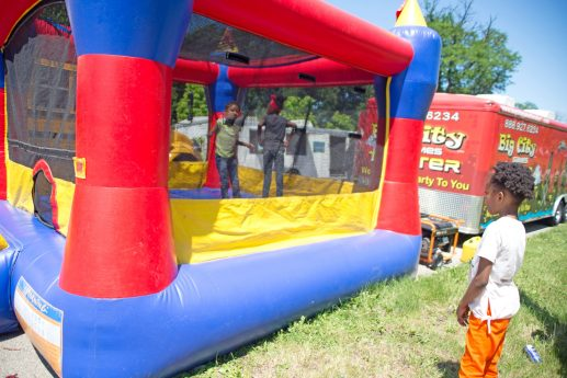 A child watches others play in the bounce house set up for kids last Saturday, during the West Side's Juneteenth Celebration at Garfield Park. | ALEXA ROGALS/Staff Photographer