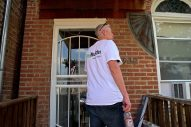 Larry Costello, with Sears, opens the new front door to Larry McLaughlin's home last Thursday, during a Rebuilding Together home renovation project in Homan Square. | By ALEXA ROGALS/Staff Photographer