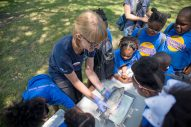 Campers watch as a fish is dissected. | ALEXA ROGALS/Staff Photographer
