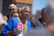 Charles Perry gives a speech last Wednesday during a ceremony marking Mandela Road's 5th anniversary and the 100th birthday celebration of Nelson Mandela outside of the Westside Health Authority on Chicago Avenue in Austin. | ALEXA ROGALS/Staff Photographer