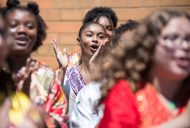A legacy in song: Members of HHW Vocal Arts Ensemble, above, perform last Wednesday, outside of the Westside Health Authority on Chicago Avenue in Austin. The ceremony was sponsored by State rep. La Shawn K. Ford. | ALEXA ROGALS/Staff Photographer