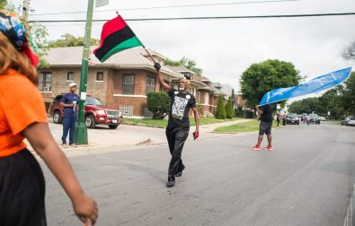 Participants march last Saturday, during Congressman Danny Davis' annual Back 2 School parade on Central Avenue in Chicago's Austin neighborhood. | Photos by ALEXA ROGALS/Staff Photographer