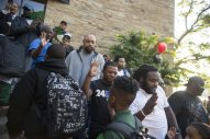 """GREETINGS: Fathers and guardians """"clap-in"""" and high five students as they walk into the school on Wednesday, Sept. 12, during the Dads Take Your Child To School day at Catalyst Circle Rock Charter School on Washington Boulevard in Austin. 