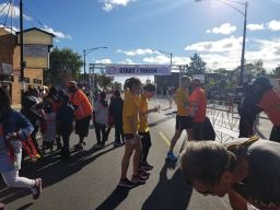 Participants who attended the annual Austin P.O.W.E.R. 5K on Sept. 22 in Austin mull about near the start/finish mark. | Photos via Facebook