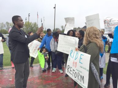RODE TO REFORM: State Rep. La Shawn K. Ford and West Side residents demonstrate outside of Stateville prison in Joliet on Oct. 5. | BONNIE McKEOWN/Contributor